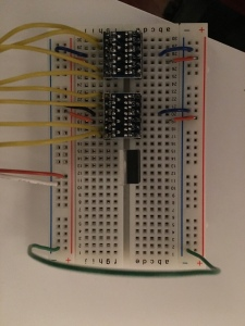 The level shifters on a breadboard. Note the 5V feeds one side, and 3.3V on the other side should come from the controller. Also, both grounds should be connected together.